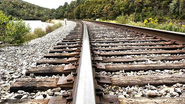railroad track spikes in railway