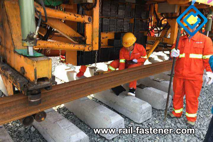 Railway sleeper transport and laying
